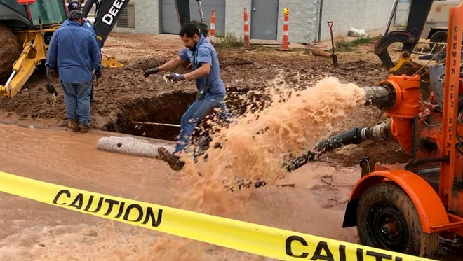 Utility crews with the City of San Angelo work to replace a 36-inch concrete water main on Southland Blvd and Green Meadow Dr. as water gushes into the street Tuesday, Feb. 20, 2018.
