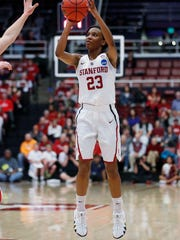 Stanford guard Kiana Williams (23) takes a 3-point shot against Gonzaga during the first half of a first-round game in the NCAA women's college basketball tournament in Stanford, Calif. on Saturday.
