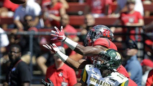 Rutgers wide receiver Leonte Carroo (4) reaches to catch a pass over Norfolk State defensive back Sandy Chapman, (10) on his way to a touchdown.