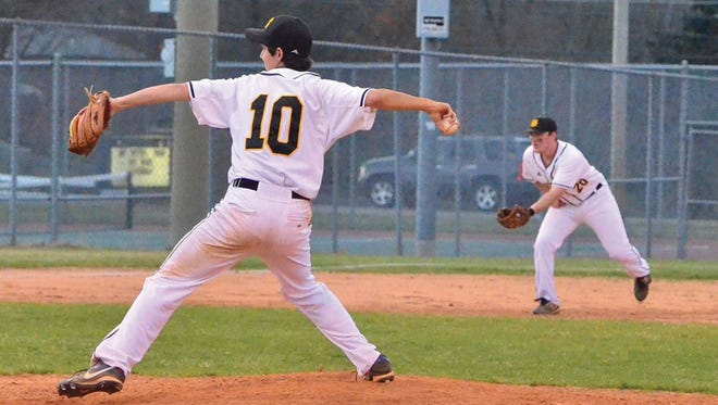 Fairview pitcher Stephen Bledsoe hung on to get the third out at the plate for a 2-0 win over Wayne County March 20.