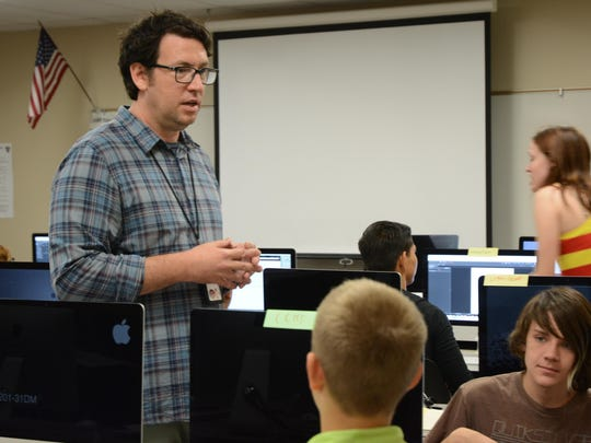 Workshop instructor Max Finneran discusses draft writing with students in DIGICOM's first screenwriting workshop.