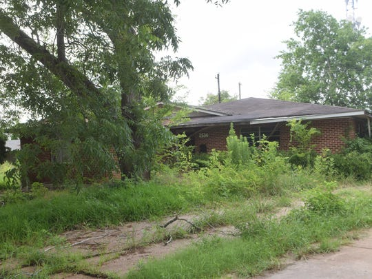 This home in Greenway Park subdivision will be torn down for a federally funded flood-mitigation project.