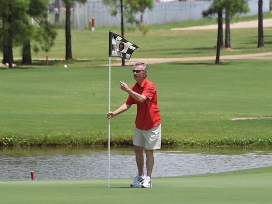 ANI Oak Wing Golf Pat Collins holds the flag at Oak Wing Golf Club Friday, June 26, 2015.-Melinda Martinez/The Town Talk
