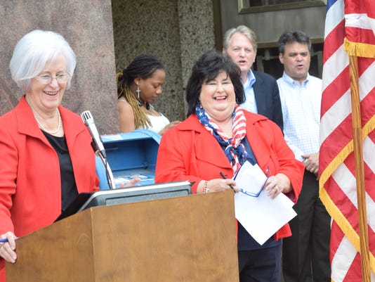 ANI Registar of Voters Linda Billings (left), a lifelong friend of Lin Dyess Stewart introduces Stewart who was sworn in as Rapides Parish registrar of voters Thursday, July 2, 2015 in front of the Rapides Parish Courthouse.-Melinda Martinez/The Town Talk