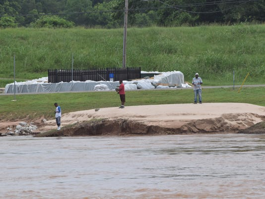 ANI River Update Fishermen stand along the banks of the Red River in Pineville. The river is receding from its crest of 36 feet just a few weeks ago.-Melinda Martinez/The Town Talk