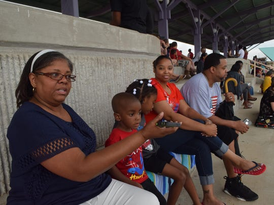 Ruby Roberts (left) of Opelousas along with family members Caleb Dean, Gabriella Harris, LaToya Cunningham and Donald Cunningham wait for the fireworks to begin Saturday in downtown Alexandria.