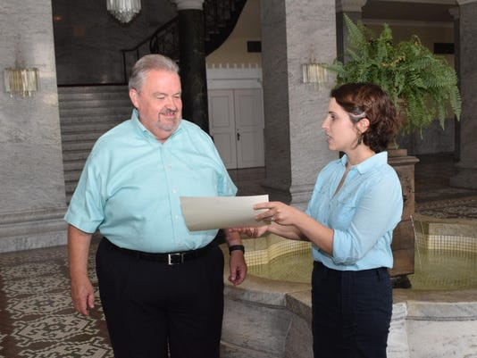ANI Jenkins Award Sarah Mason (right), director of the Alexandria Historic Preservation Commission, presents Michael Jenkins, owner of the Hotel Bentley in downtown Alexandria, a preservation in progress award Wednesday, July 8, 2015.-Melinda Martinez/The