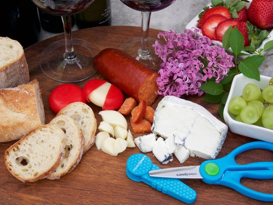 BiteSizers portable food scissors can help prepare the cheese plate at your next picnic.
