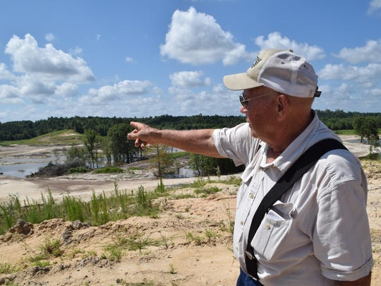 Henry Byrd, chairman of the Bayou DeChene Reservoir Commission, points to where a lake is being developed in the Bayou DeChene Watershed near Columbia. The lake supply fresh will water supply for municipal use. It will also be used as a recreation area. For the past few years, the Louisiana National Guard's 225th Engineer Brigade has hauled more than 723,000 cubic yards of material from the area to create a road along the future reservoir.