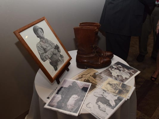 ANI Hotel Bentley La. Maneuvers Exhibit Pat Waters the grandson of Gen. George S. Patton brought his grandfather's boots to a reception held Friday for the opening of the Louisiana Maneuvers exhibit at the Hotel Bentley.-Melinda Martinez/The Town Talk