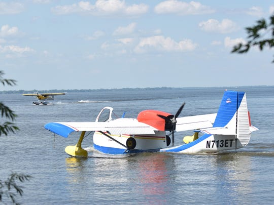 A Republic RC-3 Seabee exits the Oshkosh Seaplane Base and heads into Lake Winnebago. The fixed wing, single-engine aircraft built in 1947 is owned by Tello Edgar of Long Island, North Carolina.