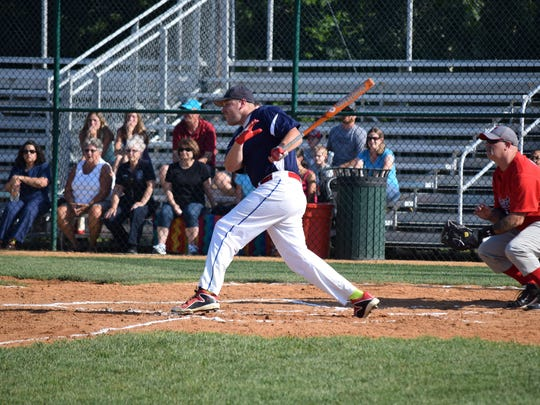 Bridgeton Police player William Cozzens hits a double during the softball game against Bridgeton Fire and Rescue.
