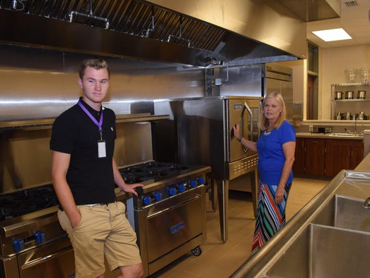 LaWanda Sexson (right), a family and consumer science teacher at Leesville High School, talks about the new commercial kitchen which was part of the school's renovations. The new kitchen will allow students to learn on equipment used in restaurants and be job-ready. LHS senior Brady Westerchil (left) conducted a tour of the school's new building and classrooms Tuesday.