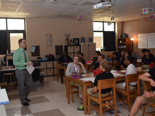 Chance McGlothin (left), a former teacher of the year from Leesville High School, conducts class Tuesday. New classrooms and buildings at Leesville High School were being utilized the first day of school in Vernon Parish.