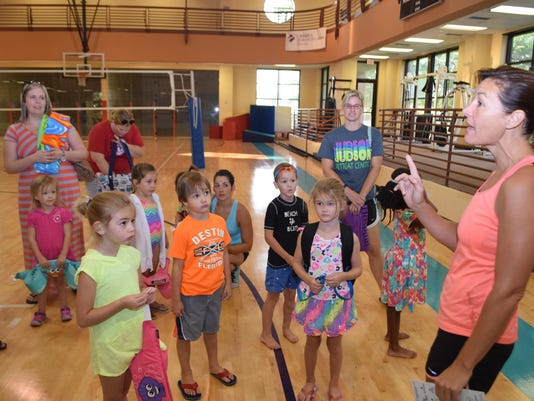 "Kids registered for Wild Kidz Tri were able to get instructions and tips at the ""Swim + Transition Tips Clinic"" held Saturday, Aug.15, 2015 at the Louisiana Athletic Club in Pineville. Children practiced swimming in the same size pool with lane ropes as ra"