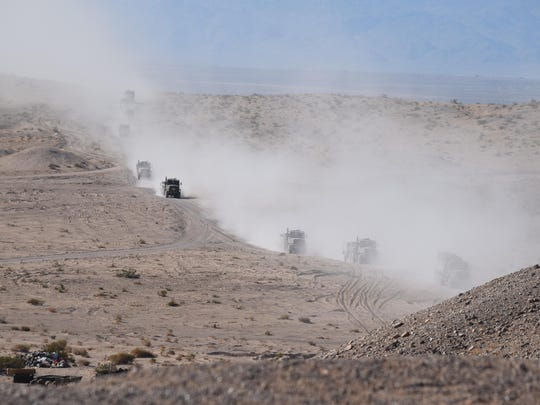 Trucks hauling artillery make their way to the 'battlefield' at Marine Corps Air Ground Combat Center in Twentynine Palms on Sunday, Aug. 16, 2015.
