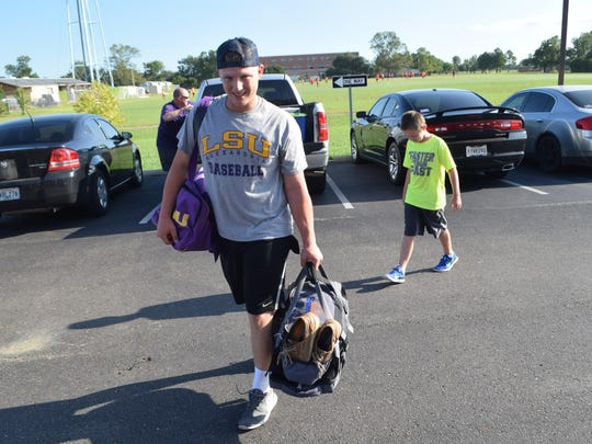 Kris Tamplet (front), a freshman LSUA baseball player from Walker, moves items into his dorm room at The Oaks with help from family members including his brother Nash Tamplet (back, right) and dad Jason Tamplet (back, left).