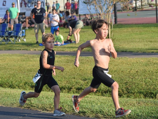 Cooper Albright (left) and Reed Cutrer (right) participate in the Wild Kidz Triathlon held Saturday at Louisiana State University of Alexandria.