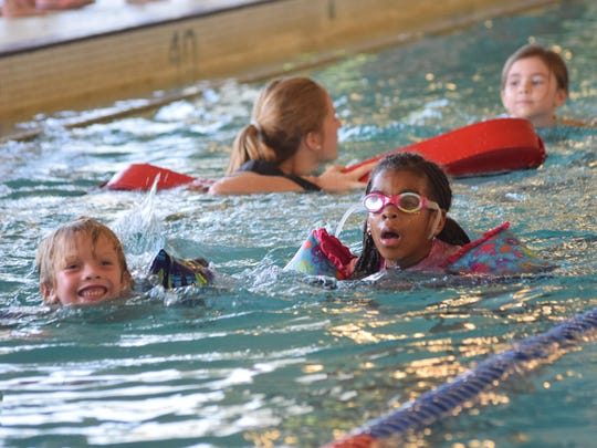Parker Sketo (left) and Emma Green swim 25 yards during the Wild Kidz Triathlon held Saturday at Louisiana State University of Alexandria.