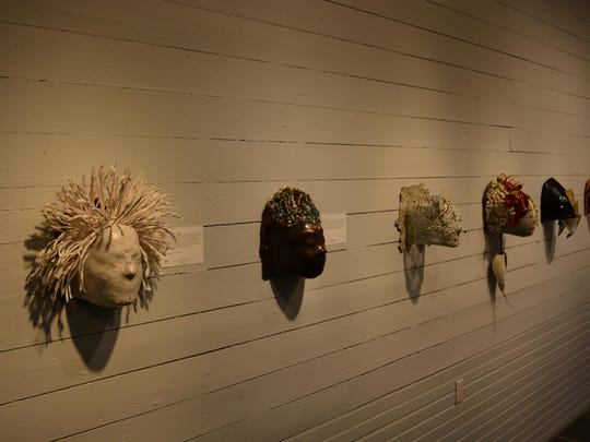 Masks from the Courage Unmasked exhibit on display in the Rehoboth Art League.
