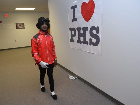 """Cameron White, a sophomore at Pineville High School and a member of the Student Council, dressed as Michael Jackson during Pineville's parents' night that had a """"Back to the Future""""/1980s theme."""