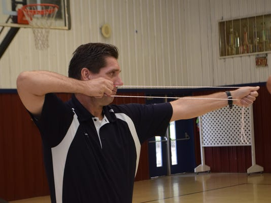 ANI Archery Jeff Adams, the physical education teacher at Acadian Elementary School, was one of about 20 P.E. coaches learning the fundamentals of archery Thursday at St. Frances Cabrini Elementary School. Training was provided through Archery in Louisiana