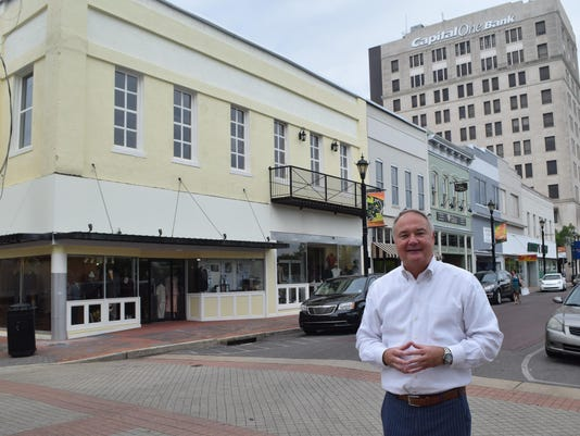 Greg Trotter talks about renovating the second floor of a building located on Third Street in downtown Alexandria. Office spaces will soon be available for rent.