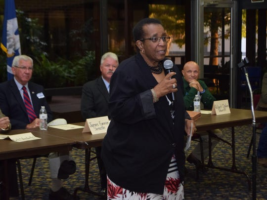 Angelina Iles, a candidate for the Rapides Parish Police Jury in District D, speaks at a candidate forum Thursday in Pineville.