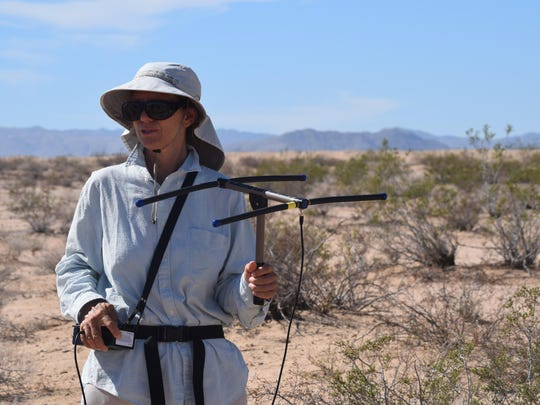 Margaret Adam, a research assistant who works with Ken Nagy, professor emeritus in the department of ecology & evolutionary biology at the University of California, Los Angeles, monitors the movement of 35 desert tortoises recently released in the wild near the Tortoise Research and Captive Rearing Site at the Marine Corps Air Ground Combat Center in Twentynine Palms. She's holding a radio receiver used to track the tortoises. Wednesday, Sept. 30, 2015.