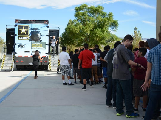 Students at Shadow Hills High School in Indio wait in line to enter the Army flight simulator.