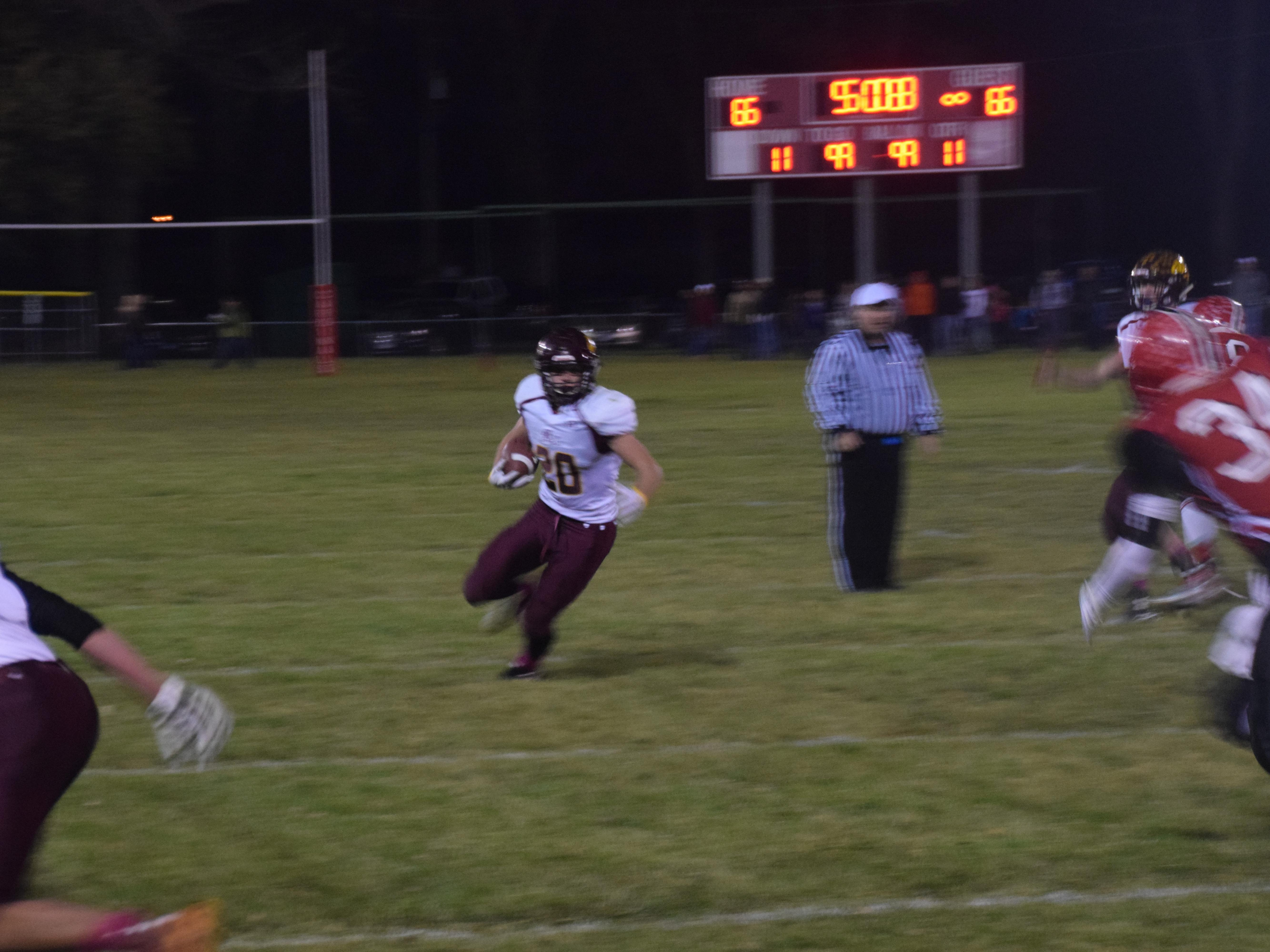 DeSmet's Matt Larson gaains several yards against Dell Rapids St. Mary on Tuesday night. The Bulldogs won the first round playoff game 42,38 in Dell Rapids.
