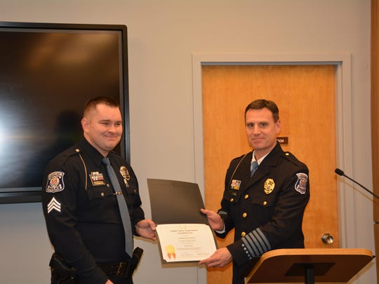 Patrick Spelman (left) was promoted to sergeant on Jan.1.