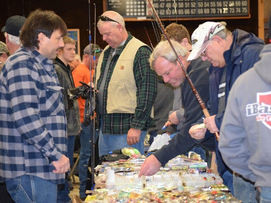 Kevin Danna of Upper Deerfield sells lures to Barry Battista and Gary Stoddard of Bellmar.