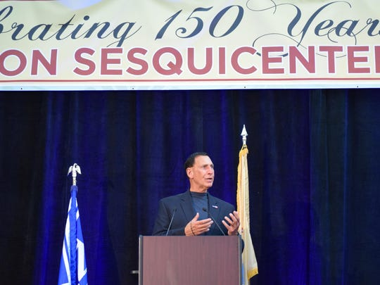 Congressman Frank A. LoBiondo addresses the crowd at the Hammonton Founders' Day Celebration in recognition of the town's 150th anniversary.