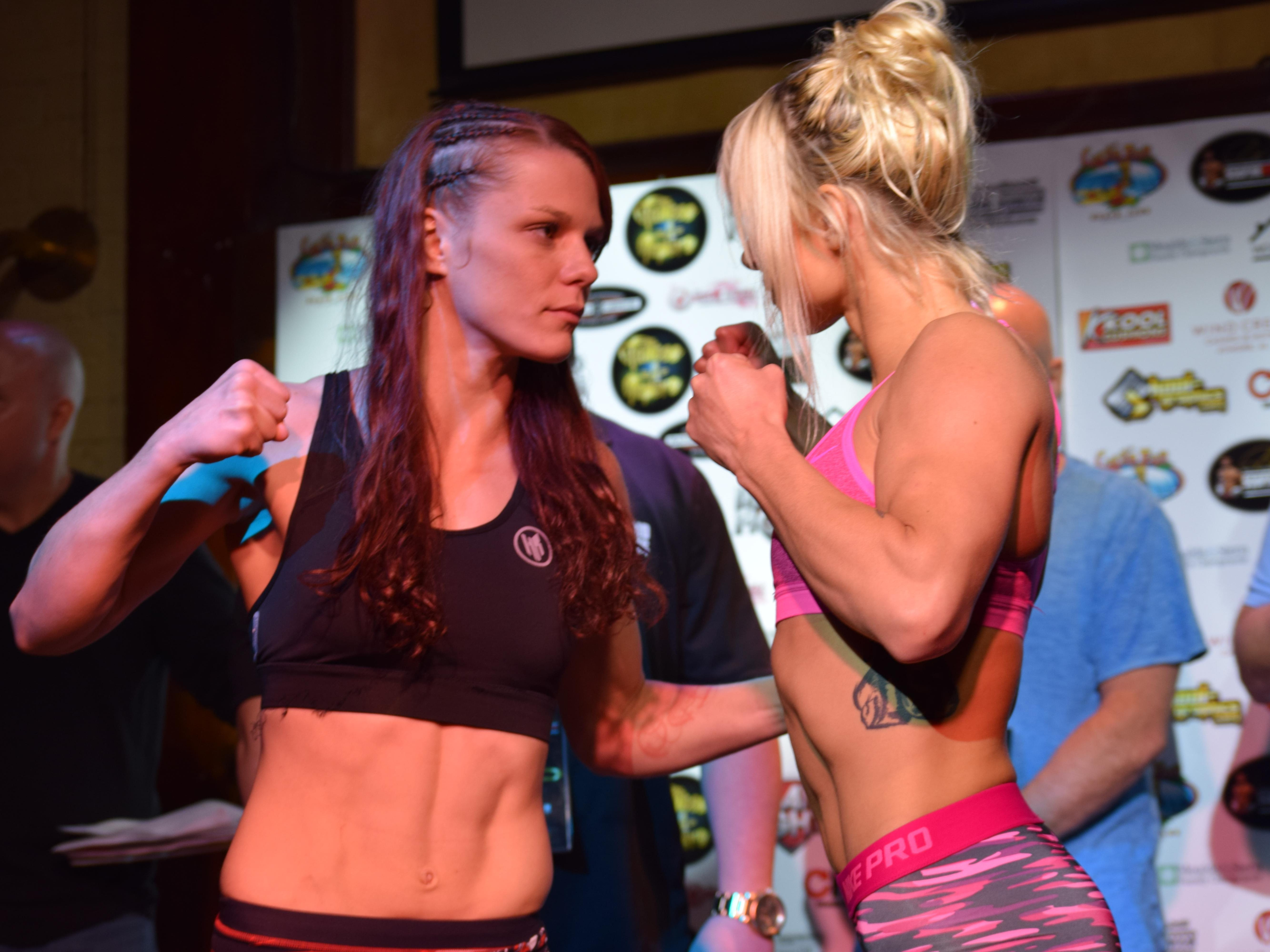 Gillian Robertson (left) and Hannah Goldy face off at Thursday's weigh-in at Seville Quarter for their fight Friday night at Island Fights 37 at Pensacola Bay Center.
