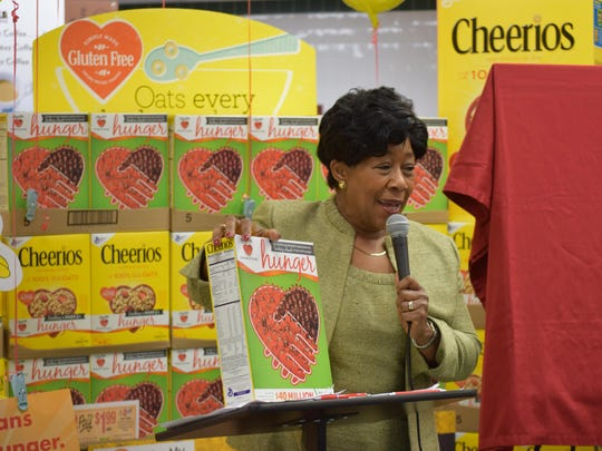 ShopRite spokesperson Orien Reid shows off the special edition Cheerios box. The box features associates from 40 of the top-raising ShopRite stores from the ShopRite Partners in Caring Cheerios Box Contest.