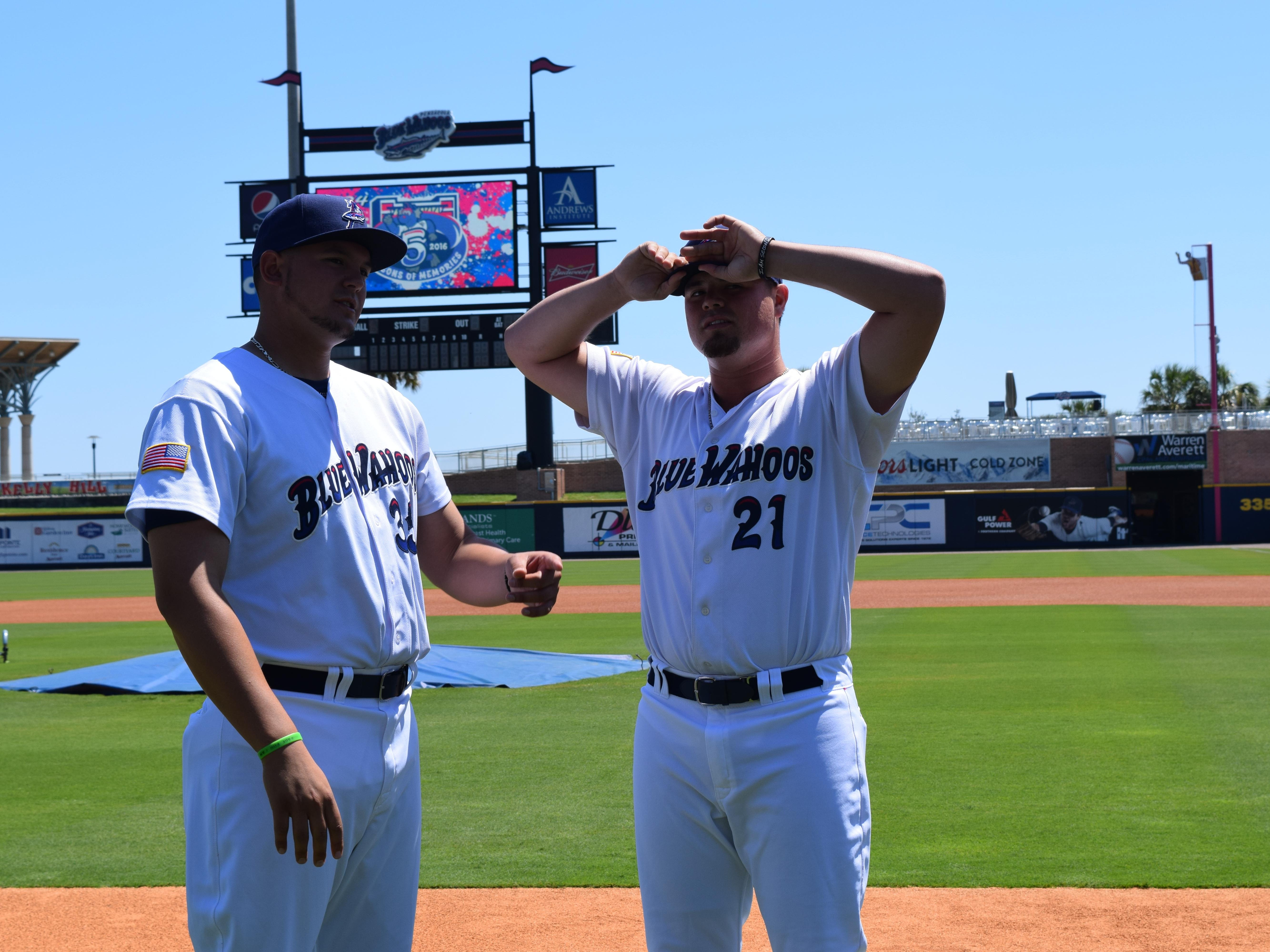 Blue Wahoos pitcher Nick Travieso, 21, named the opening day starter, chats with fellow pitcher Nick Routt prior to Tuesday's practice. Travieso played against Pace High as first baseman in the 2012 Class 6A state championship.