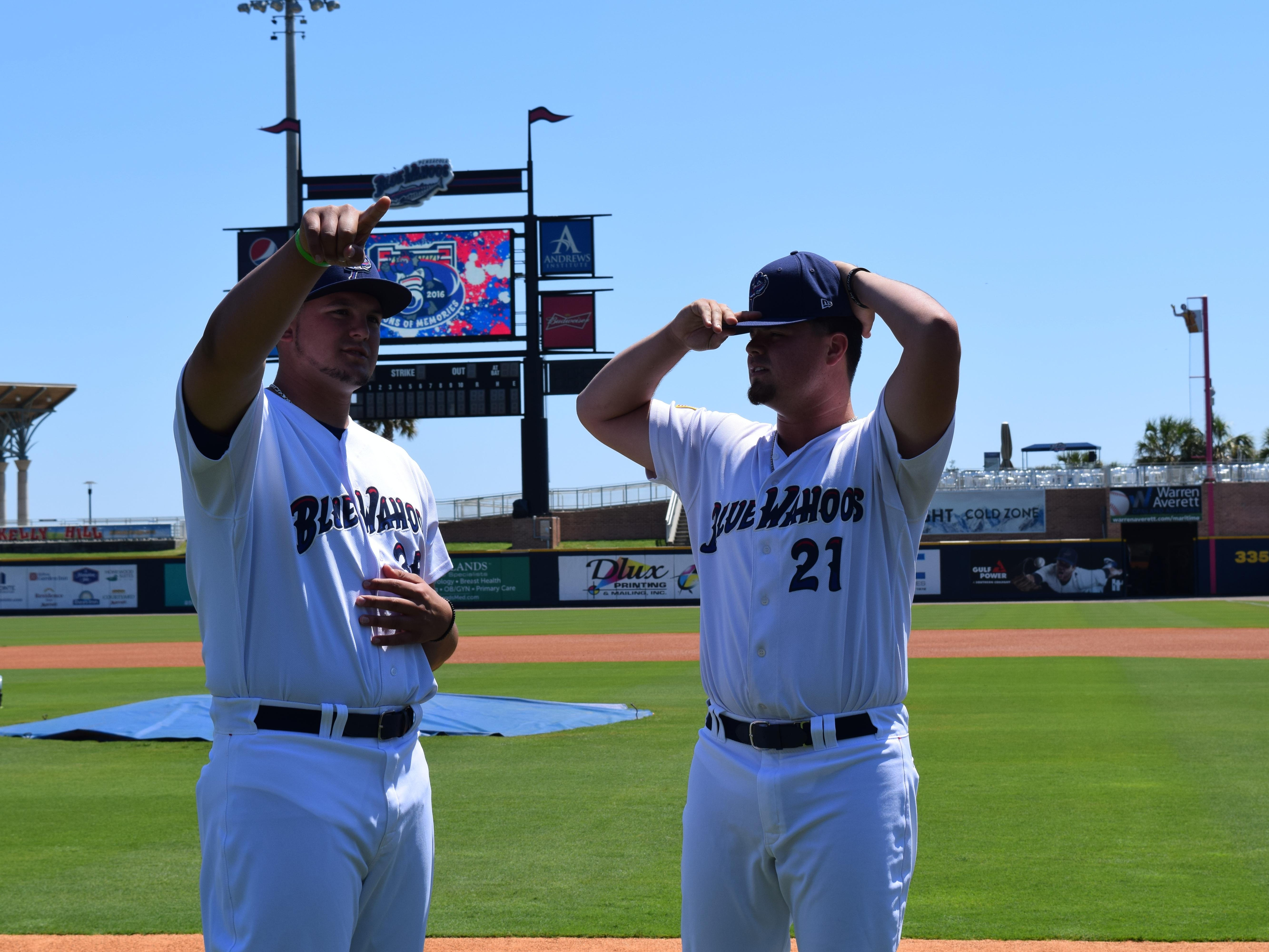 Blue Wahoos pitcher Nick Travieso, 21, named the opening day starter, chats with fellow pitcher Nick Routt prior to Tuesday's practice. Travieso pitched against Pace High in the 2012 Class 6A state championship.