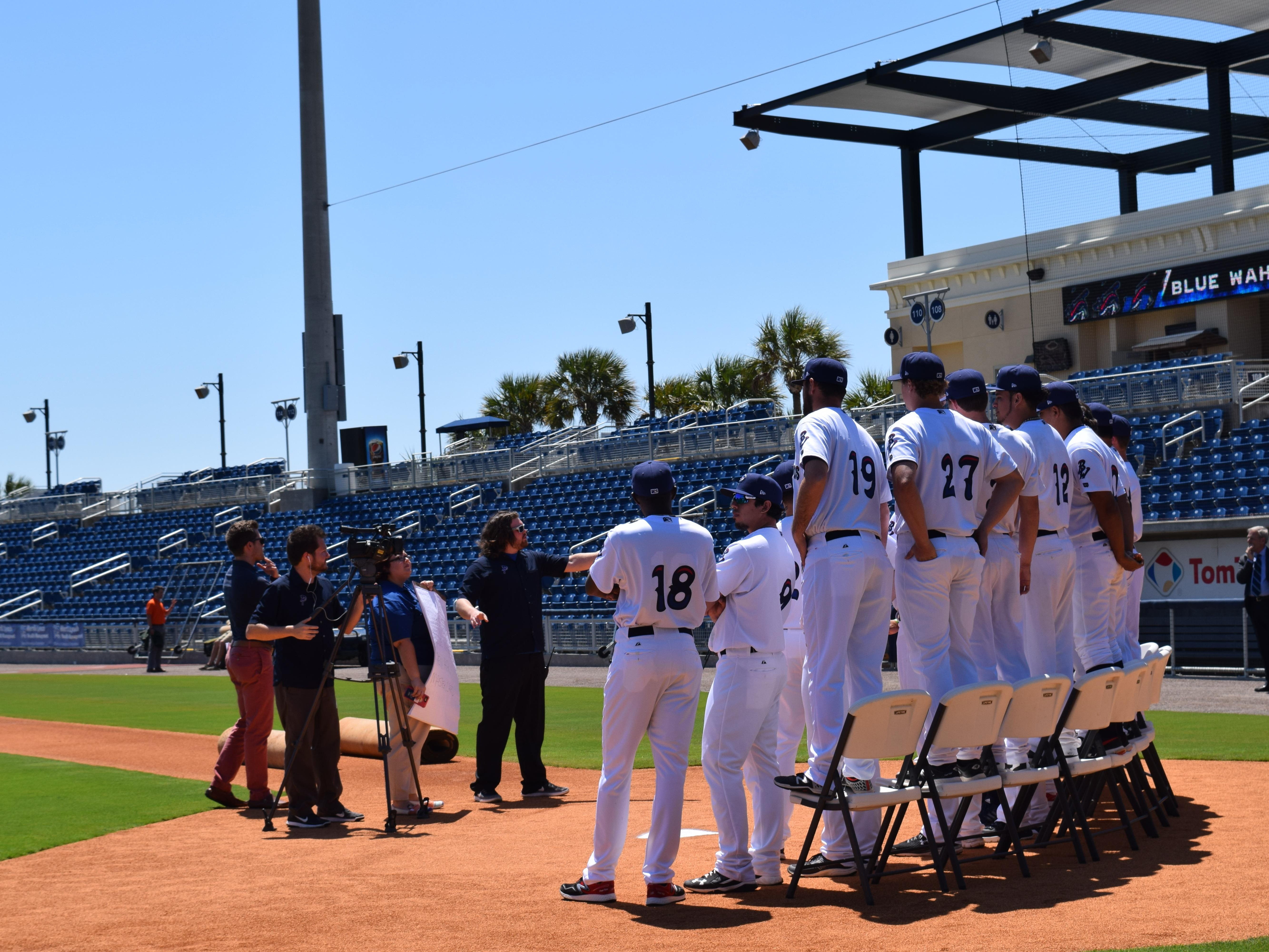 The Blue Wahoos players filmed a sponsor commercial Tuesday prior to their first practice at Blue Wahoos Stadium.