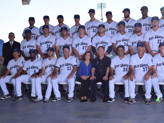 Team owners Quint and Rishy Studer (seated, front row) join Blue Wahoos players and staff for a team photo Tuesday on the Hancock Club level of Blue Wahoos Stadium.
