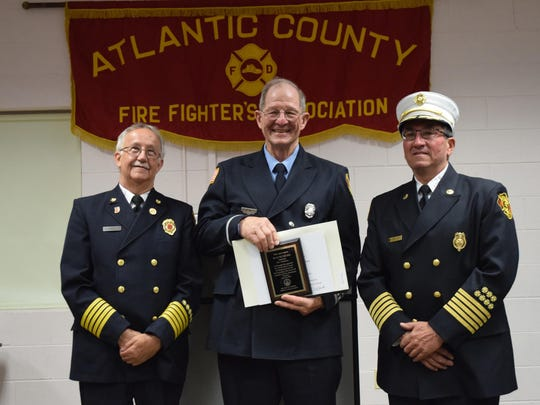 "Wayne Dilks, center, of the Linwood Fire Department, received a 50 year membership award from the Atlantic County Firefighters Association. He is pictured with Amor ""Skip"" Portale, president of the Atlantic County Firefighters Association, and Martin B. Walley, chief of the Linwood Fire Department."