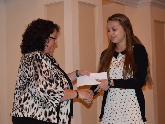 Robin Moore, president of the Cape-Atllantic Principals and Supervisors Association, presents the 11th annual CAPSA Award to Caroline Roth, 18, of North Cape May.