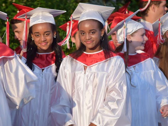 Gabrielle Johnson, 17, and Dominique Johnson, 17, both of Franklinville, are pictured with the St. Joseph High School Class of 2016 before the 77th Commencement exercises on May 31.