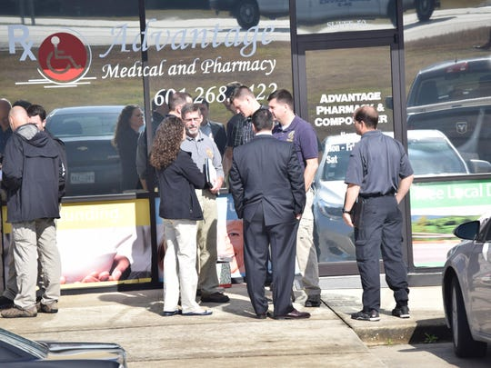 Law enforcement agents raid Advantage Medical and Pharmacy in Hattiesburg, Mississippi in January 2016. The pharmacy raid is part of a massive Mississippi health care fraud case that is linked to a pain cream conspiracy that stretched from California to Tennessee.