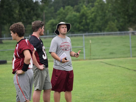 Northview coach Derek Marshman talks to one of his players during a recent practice.