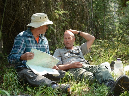 Continental Divide Trail Montana volunteer Norman Fortunate discusses the afternoon's trailwork with Bill Hopkins, Yellowstone National Park Cooperative Groups Coordinator on Aug. 31.