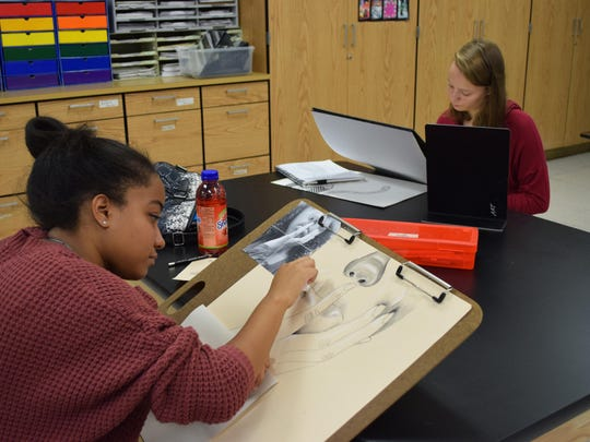 Nina Sample, 17, a senior, works on her project during the advanced art class at Egg Harbor Township High School.