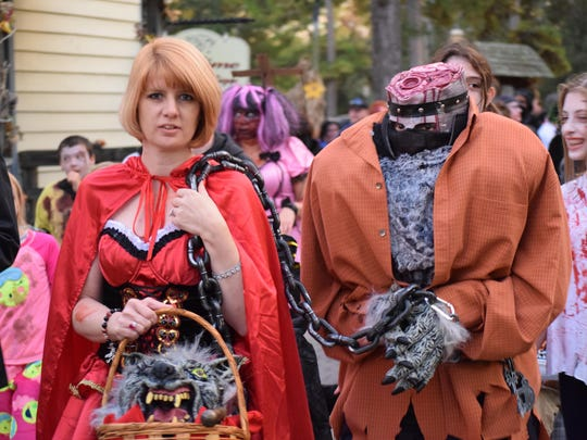Pam and Don Delessio of Mullica Hill dressed as Little Red Riding Hood and the Wolf for the Smithville Zombie Walk. The wolf's head is in her basket.