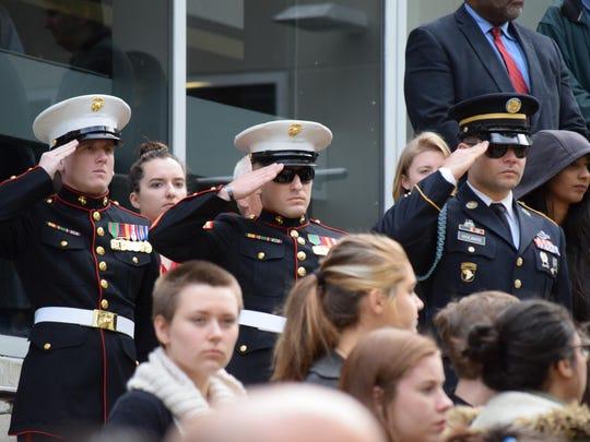 Servicemen salute during Taps at the Stockton University's Veterans Day program.
