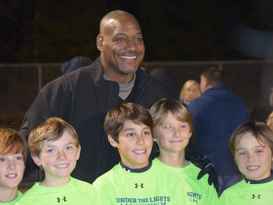 Pro Football Hall of Famer Derrick Brooks meets with players in 2017 in the winter flag football league he helps co-sponsor at Blue Wahoos Stadium.